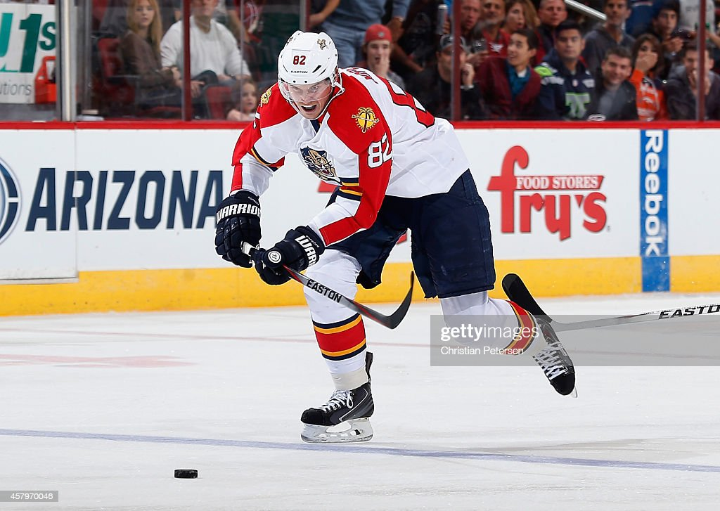 Tomas Kopecky of the Florida Panthers skates with the puck during the NHL game against the Arizona Coyotes at Gila River Arena on October 25 2014 in...