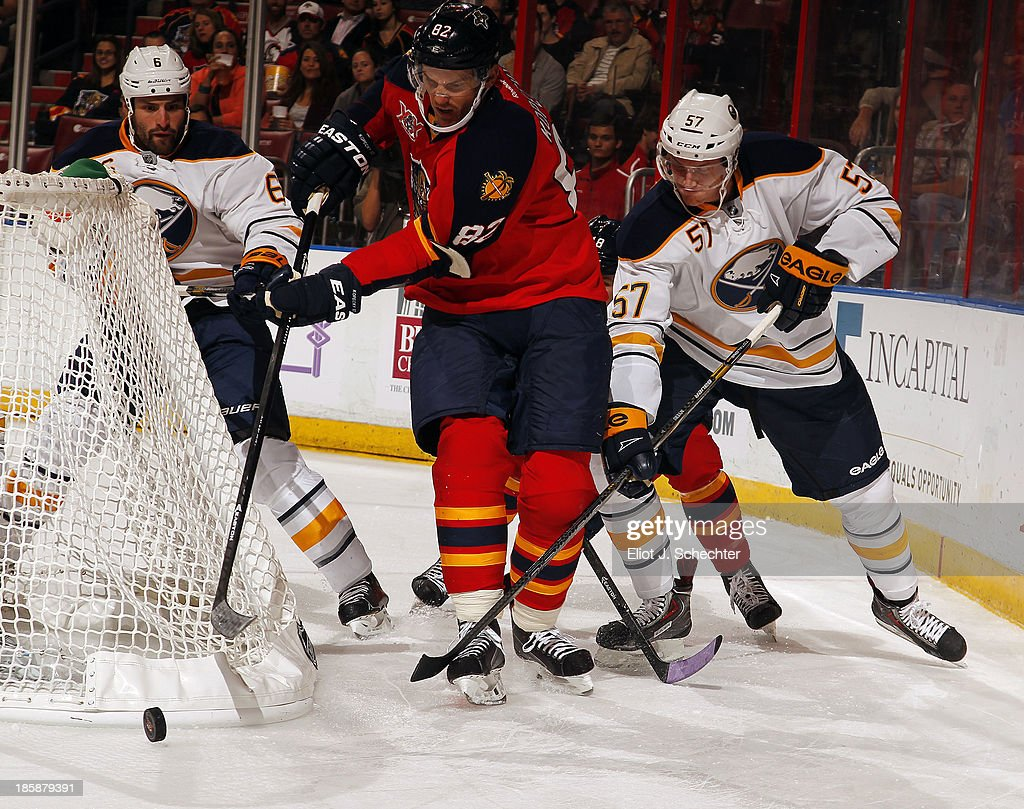Tomas Kopecky #82 of the Florida Panthers tangles with Tyler Myers #57 of the Buffalo Sabres at the BB&T Center on October 25, 2013 in Sunrise, Florida.