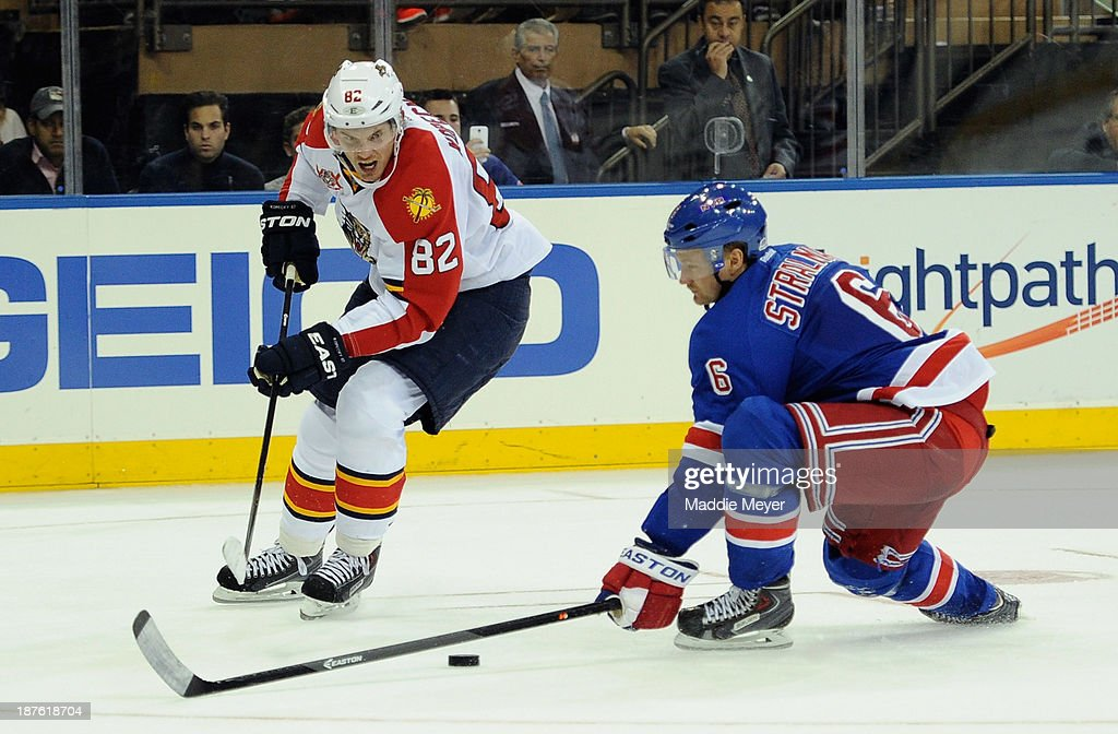 Tomas Kopecky skates against Ryan Whitney #6 of the Florida Panthers during the third period at Madison Square Garden on November 10, 2013 in New York City. The Rangers defeat the Panthers 4-3.