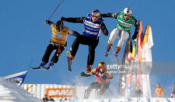 Tomas Kraus of Czech Republic Simon Bastellica of France and Hiroomi Takizawa of Japan in action during the FIS Men's Freestyle World Cup Ski Cross...