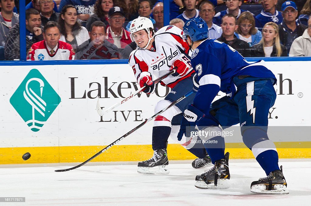 Tomas Kundratek #36 of the Washington Capitals shoots the puck against Keith Aulie #3 of the Tampa Bay Lightning during the second period of the game at the Tampa Bay Times Forum on February 14, 2013 in Tampa, Florida.