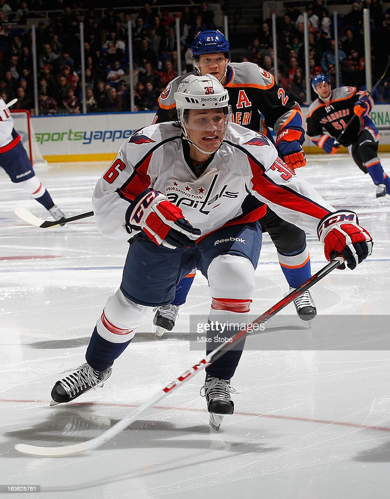 Tomas Kundratek #36 of the Washington Capitals skates against the New York Islanders at Nassau Veterans Memorial Coliseum on March 9, 2013 in Uniondale, New York. The Islanders defeated the Capitals 5-2.