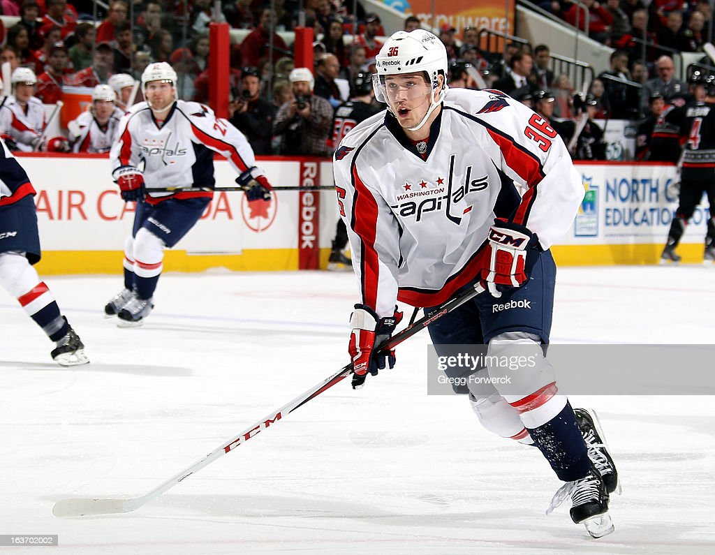 Tomas Kundratek #36 of the Washington Capitals skates hard across the blue line during an NHL game against the Carolina Hurricanes at PNC Arena on March 14, 2013 in Raleigh, North Carolina.