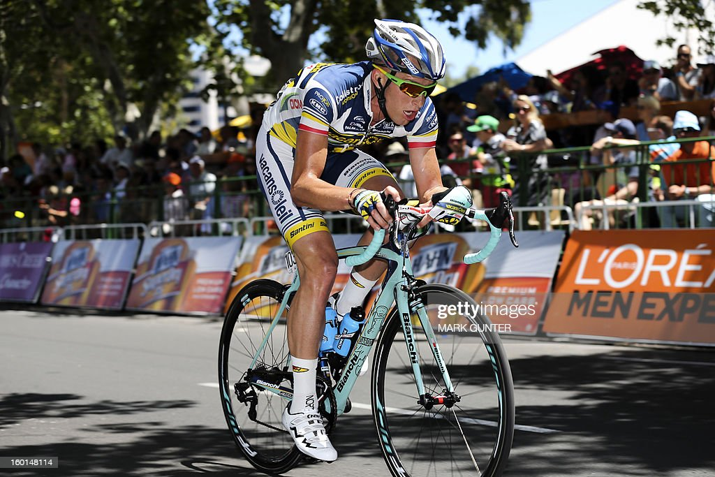 Tomas Marczynski of Poland rides during a break attempt in the 90-km stage 6 around the streets of Adelaide on the final day of the Tour Down Under cycling race on January 27, 2013. AFP PHOTO / Mark Gunter USE