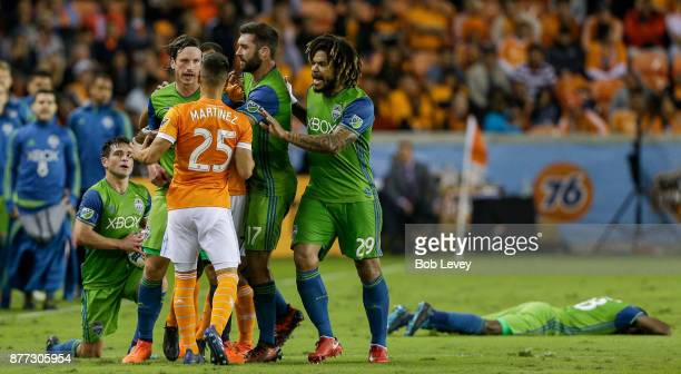 Tomas Martinez of Houston Dynamo gets into a scrimish with Gustav Svensson of Seattle Sounders and Will Bruin and Roman Torres in the second half at...