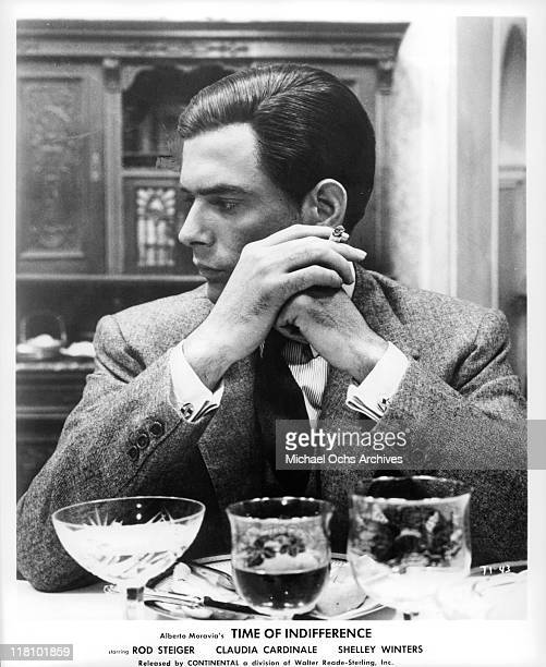 Tomas Milian at the table in a scene from the film 'Time of Indifference' 1964