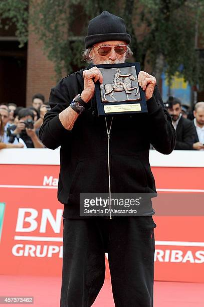 Tomas Milian poses on The Red Carpet with the Marc Aurelio Acting Award during the 9th Rome Film Festival on October 17 2014 in Rome Italy