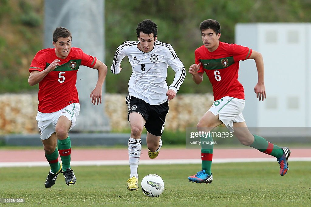 Tomas Mota and Ruben Neves of Portugal challenge Levin Oztunali (C) of Germany during the Under17 Algarve Youth Cup match between U17 Portugal and U17 Germany at the Stadium Bela Vista on February 12, 2013 in Parchal, Portugal.