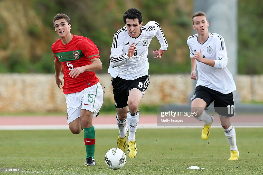 Tomas Mota (L) of Portugal challenges Levin Oztunali of Germany during the Under17 Algarve Youth Cup match between U17 Portugal and U17 Germany at the Stadium Bela Vista on February 12, 2013 in Parchal, Portugal.