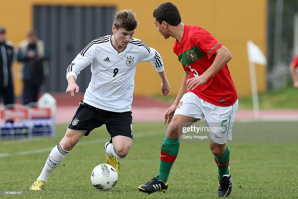 Tomas Mota (R) of Portugal challenges Timo Werner of Germany during the Under17 Algarve Youth Cup match between U17 Portugal and U17 Germany at the Stadium Bela Vista on February 12, 2013 in Parchal, Portugal.