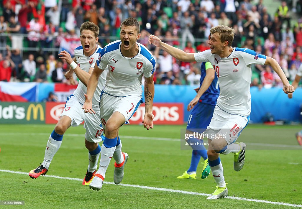 Tomas Necid of Czech Republic celebrates with Milan Skoda and Ladislav Krejci after he scores from the penalty spot to make the score 2-2 during the UEFA EURO 2016 Group D match between Czech Republic and Croatia at Stade Geoffroy-Guichard on June 17, 2016 in Saint-Etienne, France.