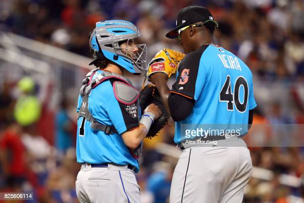 Tomas Nido and Thyago Vieira of the World Team meet on the mound during the SirusXM AllStar Futures Game at Marlins Park on Sunday July 9 2017 in...