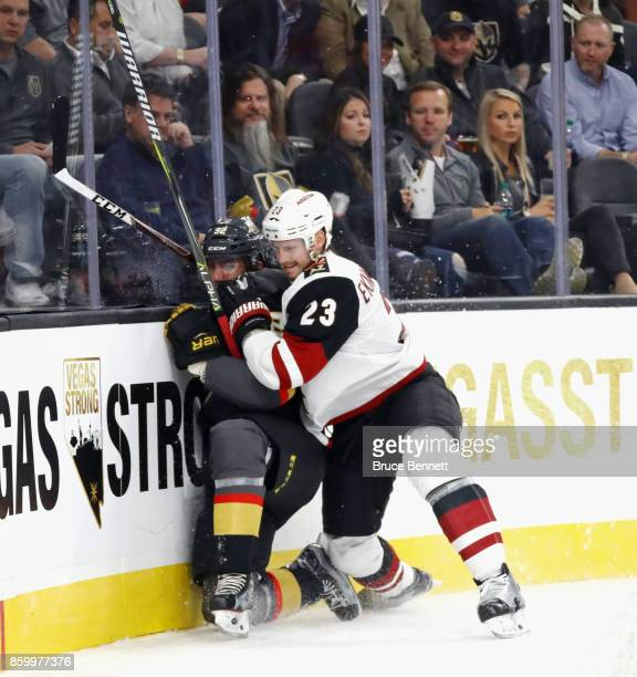 Tomas Nosek of the Vegas Golden Knights is hit into the boards by Oliver EkmanLarsson of the Arizona Coyotes during the second period during the...