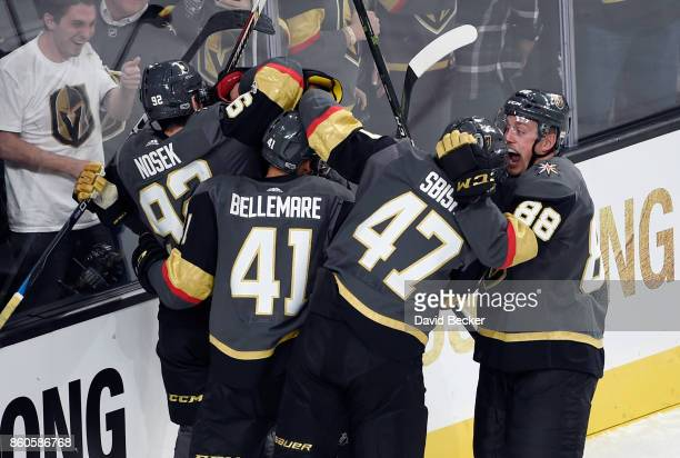 Tomas Nosek PierreEdouard Bellemare Luca Sbisa and Nate Schmidt of the Vegas Golden Knights celebrate a goal against the Arizona Coyotes at TMobile...