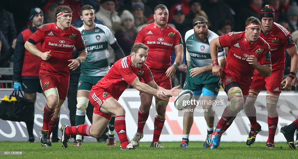Tomas O'Leary of Munster passes the ball during the European Rugby Champions Cup match between Munster and Leicester Tigers at Thomond Park on December 12, 2015 in Limerick, Ireland.