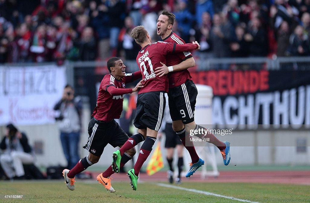 Tomas Pekhart of Nuernberg celebrates with teammates after scoring his team's second goal during the Bundesliga match between 1 FC Nuernberg and...