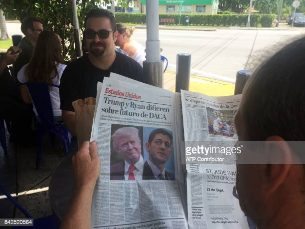 Tomas Pendola has a coffee in his favorite Cuban Café in Little Havana while another customer reads a newspaper's article about the future of DACA...