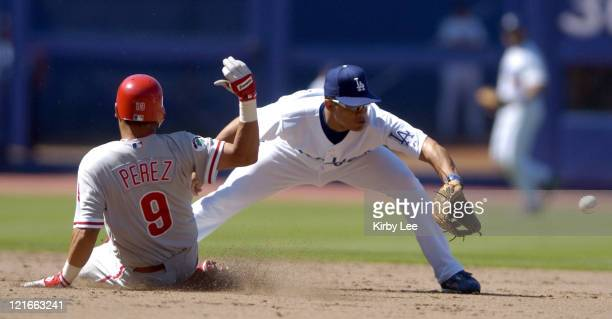 Tomas Perez of the Philadelphia Phillies slides safely into second base beneath tag of Alex Cora during 41 victory at Dodger Stadium on Sunday August...