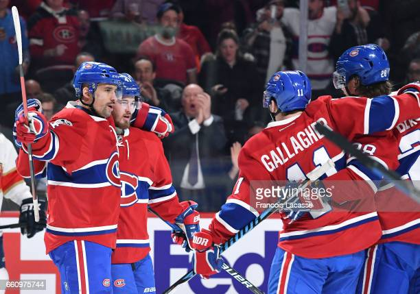 Tomas Plekanec and Paul Byron of the Montreal Canadiens celebrate a goal against the Florida Panthers in the NHL game at the Bell Centre on March 30...