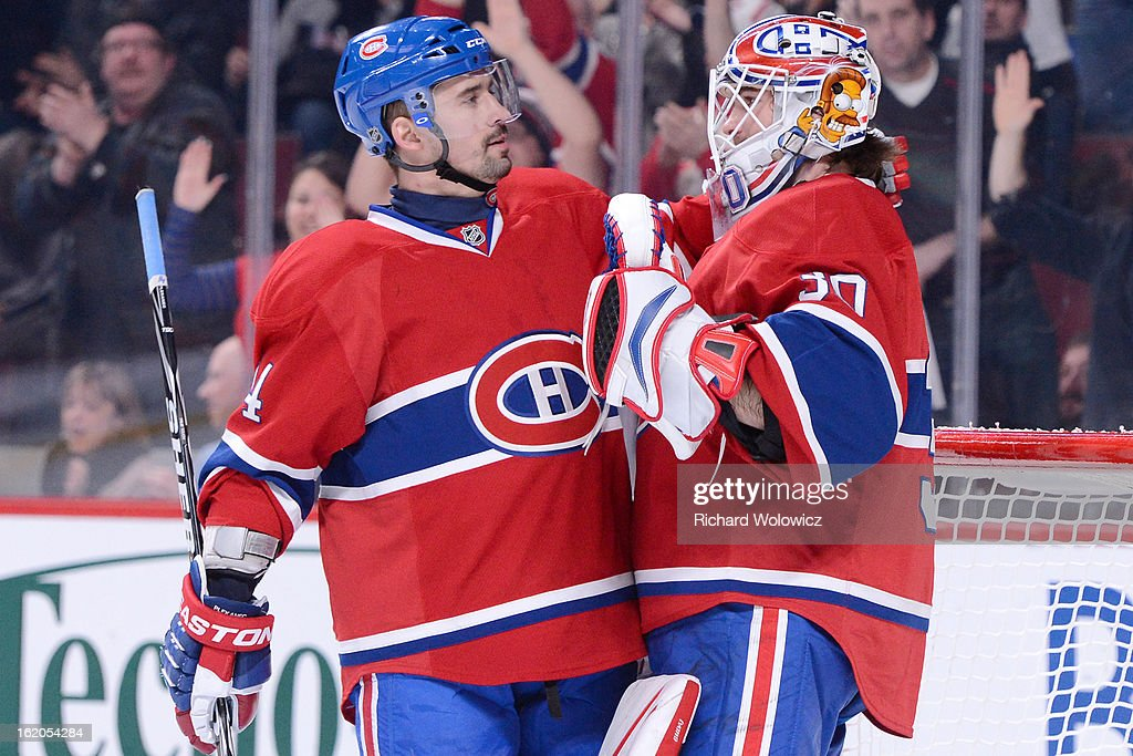 <a gi-track='captionPersonalityLinkClicked' href=/galleries/search?phrase=Tomas+Plekanec&family=editorial&specificpeople=620244 ng-click='$event.stopPropagation()'>Tomas Plekanec</a> #14 and <a gi-track='captionPersonalityLinkClicked' href=/galleries/search?phrase=Peter+Budaj&family=editorial&specificpeople=228123 ng-click='$event.stopPropagation()'>Peter Budaj</a> #30 of the Montreal Canadiens celebrate after defeating the Carolina Hurricanes during the NHL game at the Bell Centre on February 18, 2013 in Montreal, Quebec, Canada. The Canadiens defeated the Hurricanes 3-0.