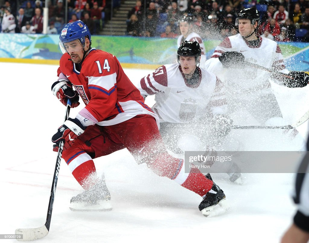 Tomas Plekanec of Czech Republic controls the puck during the ice hockey Men's Playoff qualification match between the Czech Republic and Latvia on...