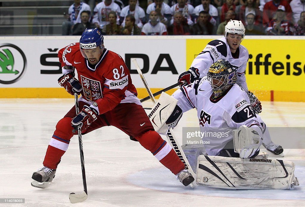 Tomas Plekanec of Czech Republic controls the puck in front of Ty Conklin goaltender of USA during the IIHF World Championship quarter final match...