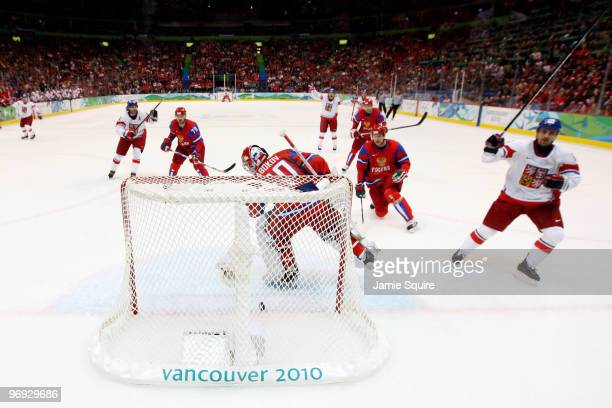 Tomas Plekanec of Czech Republic scorea a first period goal against Evgeni Nabokov of the Russian Federation during the ice hockey men's preliminary...