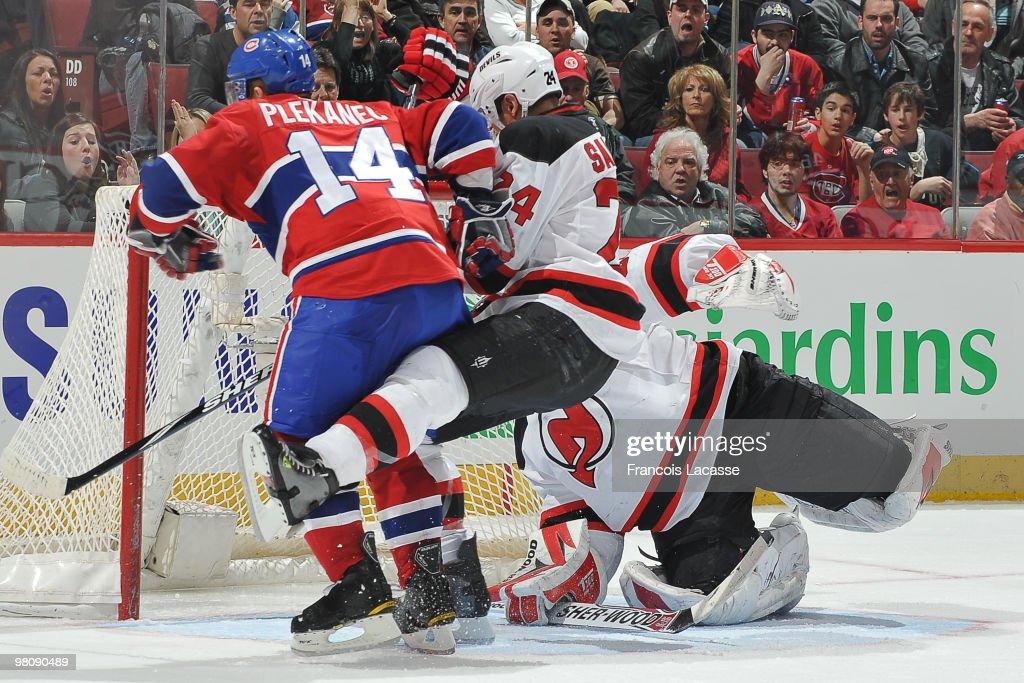 Tomas Plekanec of Montreal Canadiens takes a shot on goalie Martin Brodeur of New Jersey Devils in front of Bryce Salvador of New Jersey Devils...