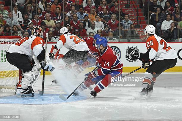 Tomas Plekanec of Montreal Canadiens takes position in front of goalie Michael Leighton of Philadelphia Flyers in Game Four of the Eastern Conference...
