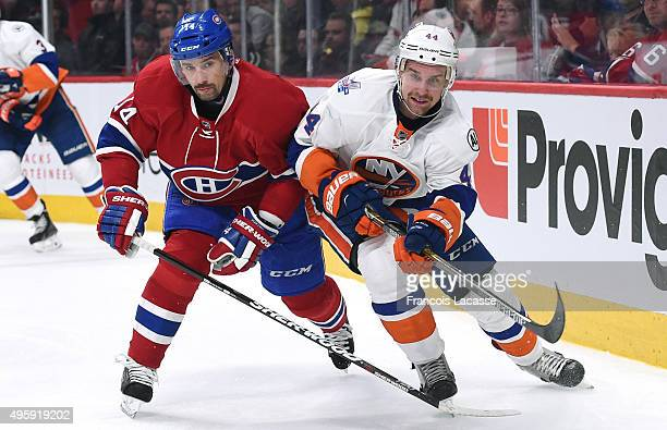 Tomas Plekanec of the Montreal Canadiens and Calvin De Haan of the New York Islanders battle for position in the NHL game at the Bell Centre on...