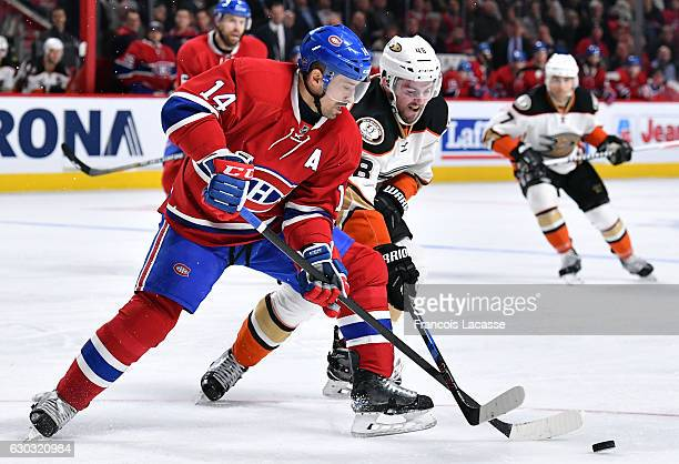 Tomas Plekanec of the Montreal Canadiens and Colby Robak of the Anaheim Ducks fight for the puck in the NHL game at the Bell Centre on December 20...