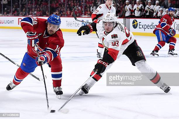 Tomas Plekanec of the Montreal Canadiens and Mika Zibanejad of the Ottawa Senators battle for the puck during Game Five of the Eastern Conference...
