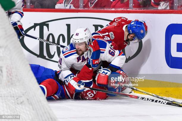 Tomas Plekanec of the Montreal Canadiens and Rick Nash of the New York Rangers fall onto Andrei Markov in Game Five of the Eastern Conference First...