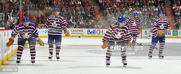 Tomas Plekanec of the Montreal Canadiens and teammates Mike Cammalleri and MarcAndre Bergeron skate for position before the face off during the NHL...