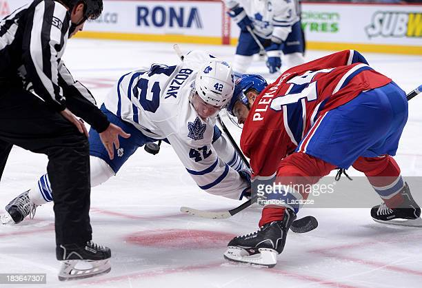 Tomas Plekanec of the Montreal Canadiens and Tyler Bozak # of the Toronto Maple Leafs 42 faceoff during the NHL game on October 1 2013 at the Bell...