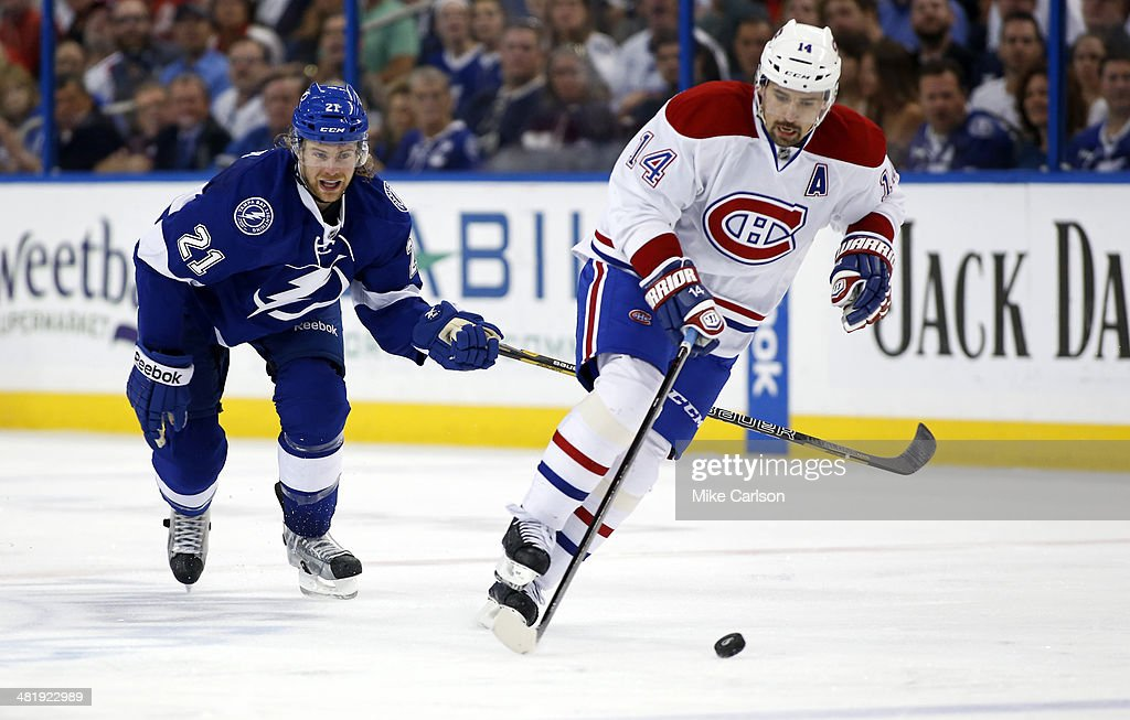 <a gi-track='captionPersonalityLinkClicked' href=/galleries/search?phrase=Tomas+Plekanec&family=editorial&specificpeople=620244 ng-click='$event.stopPropagation()'>Tomas Plekanec</a> #14 of the Montreal Canadiens avoids a check from <a gi-track='captionPersonalityLinkClicked' href=/galleries/search?phrase=Mike+Kostka&family=editorial&specificpeople=2193393 ng-click='$event.stopPropagation()'>Mike Kostka</a> #21 of the Tampa Bay Lightning at the Tampa Bay Times Forum on April 1, 2014 in Tampa, Florida.
