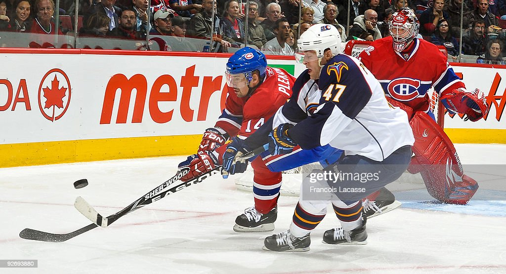 Tomas Plekanec of the Montreal Canadiens battles for the puck with Rich Peverley of the Atlanta Thrashers during the NHL game on November 3 2009 at...