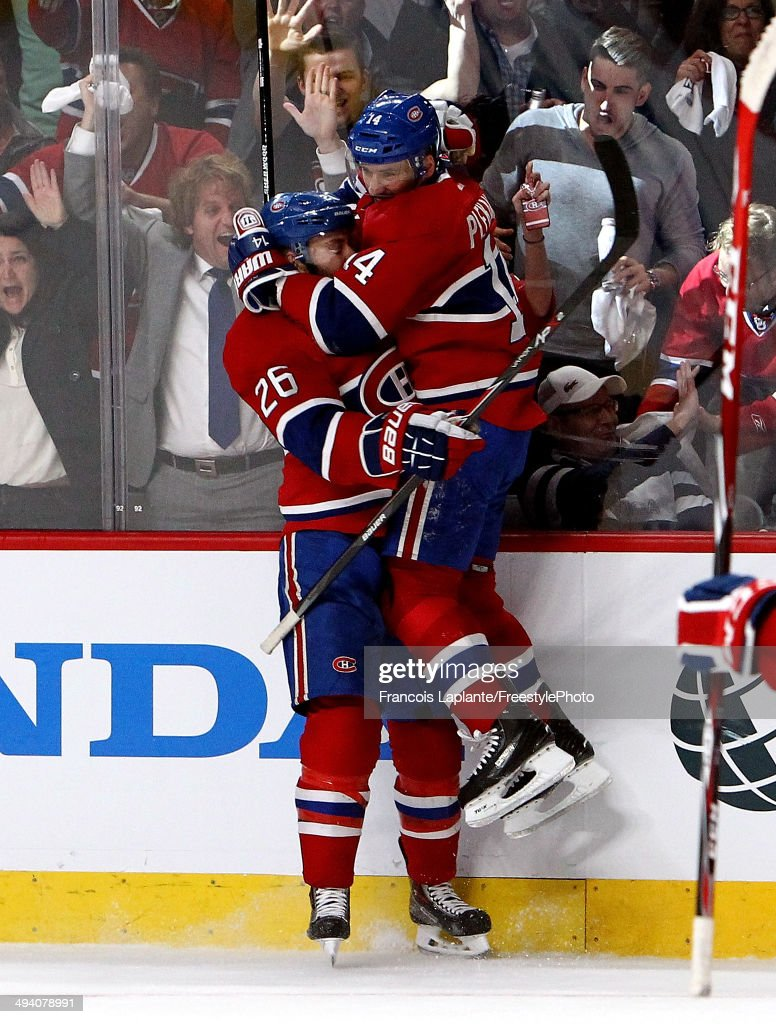 Tomas Plekanec of the Montreal Canadiens celebrateds his first period goal with Josh Gorges of the Montreal Canadiens against the New York Rangers...