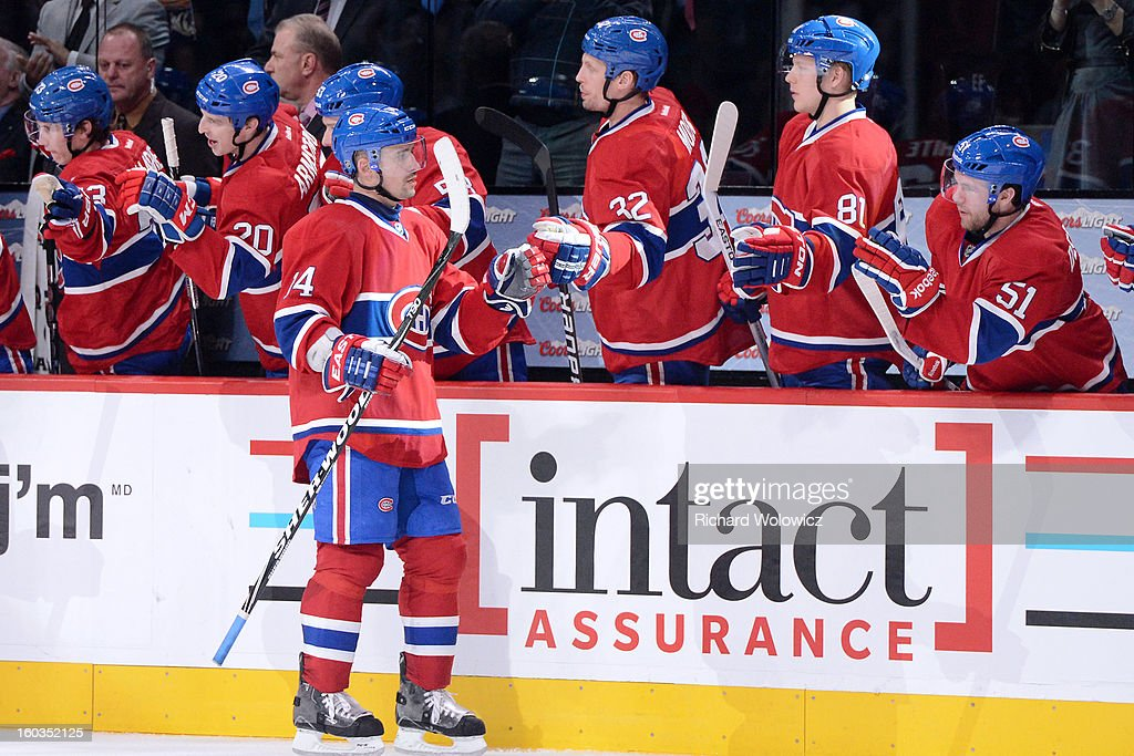 <a gi-track='captionPersonalityLinkClicked' href=/galleries/search?phrase=Tomas+Plekanec&family=editorial&specificpeople=620244 ng-click='$event.stopPropagation()'>Tomas Plekanec</a> #14 of the Montreal Canadiens celebrates his game winning goal with teammates during the NHL game against the Winnipeg Jets at the Bell Centre on January 29, 2013 in Montreal, Quebec, Canada. The Canadiens defeated the Jets 4-3.