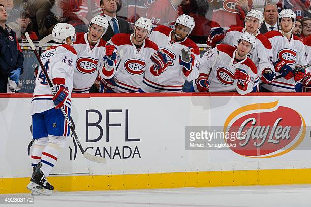 Tomas Plekanec of the Montreal Canadiens celebrates his goal with teammates during the NHL game against the Ottawa Senators at Canadian Tire Centre...