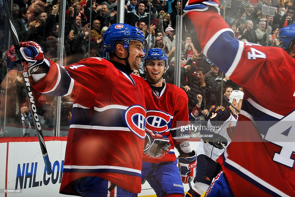 Tomas Plekanec of the Montreal Canadiens celebrates his goal with teammate Maxim Lapierre during the NHL game against the Atlanta Thrashers on...