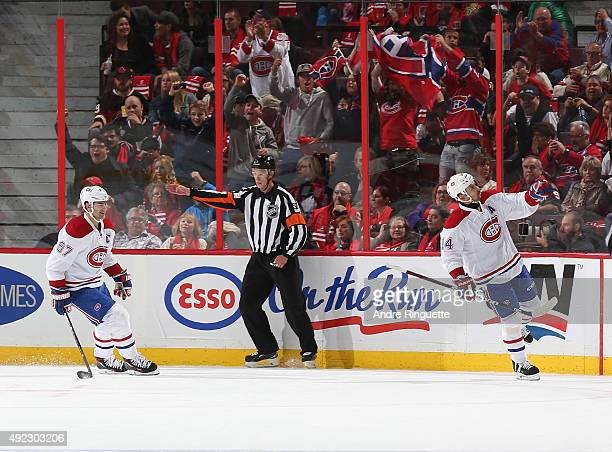 Tomas Plekanec of the Montreal Canadiens celebrates his second goal of the game against the Ottawa Senators with teammate Max Pacioretty at Canadian...