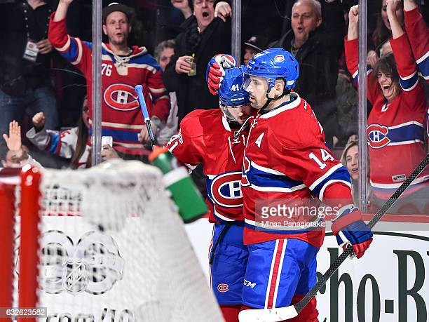 Tomas Plekanec of the Montreal Canadiens celebrates his short handed goal with teammate Paul Byron during the NHL game against the Calgary Flames at...