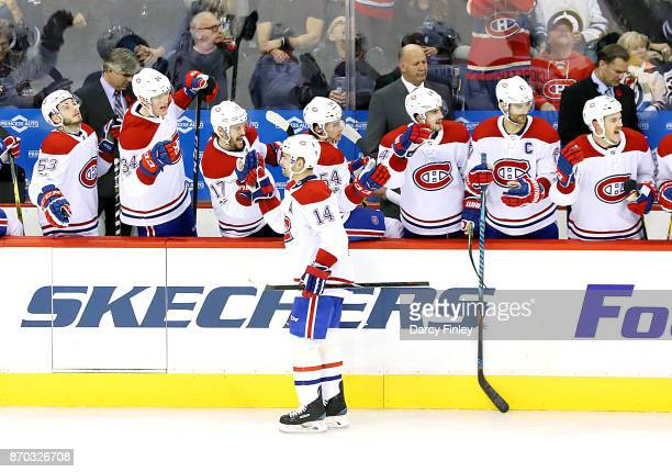 Tomas Plekanec of the Montreal Canadiens celebrates his third period goal against the Winnipeg Jets with teammates at the bench at the Bell MTS Place...