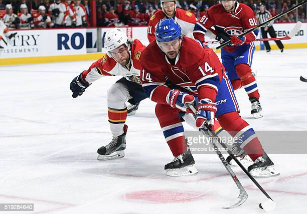Tomas Plekanec of the Montreal Canadiens controls the puck against Aaron Ekblad of the Florida Panthers in the NHL game at the Bell Centre on April 5...
