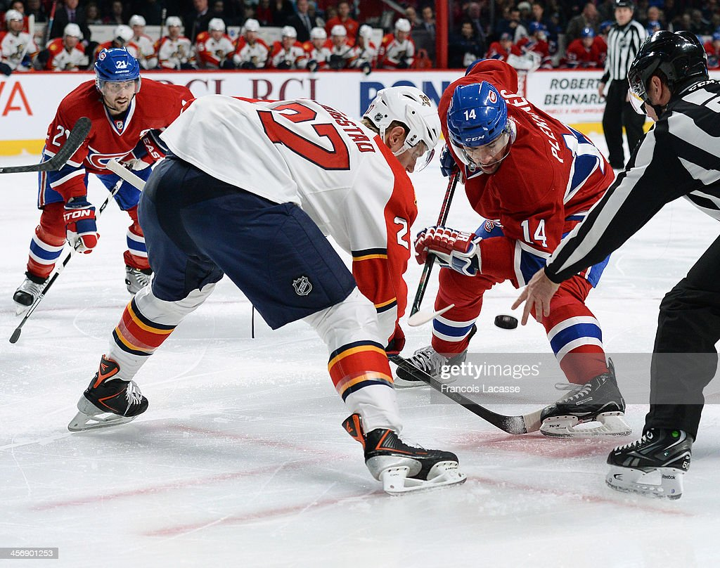 <a gi-track='captionPersonalityLinkClicked' href=/galleries/search?phrase=Tomas+Plekanec&family=editorial&specificpeople=620244 ng-click='$event.stopPropagation()'>Tomas Plekanec</a> #14 of the Montreal Canadiens, faces off against <a gi-track='captionPersonalityLinkClicked' href=/galleries/search?phrase=Nick+Bjugstad&family=editorial&specificpeople=7029343 ng-click='$event.stopPropagation()'>Nick Bjugstad</a> #27 of the Florida Panthers while <a gi-track='captionPersonalityLinkClicked' href=/galleries/search?phrase=Brian+Gionta&family=editorial&specificpeople=202116 ng-click='$event.stopPropagation()'>Brian Gionta</a> #21 watches for the attack during the NHL game on December 15, 2013 at the Bell Centre in Montreal, Quebec, Canada.