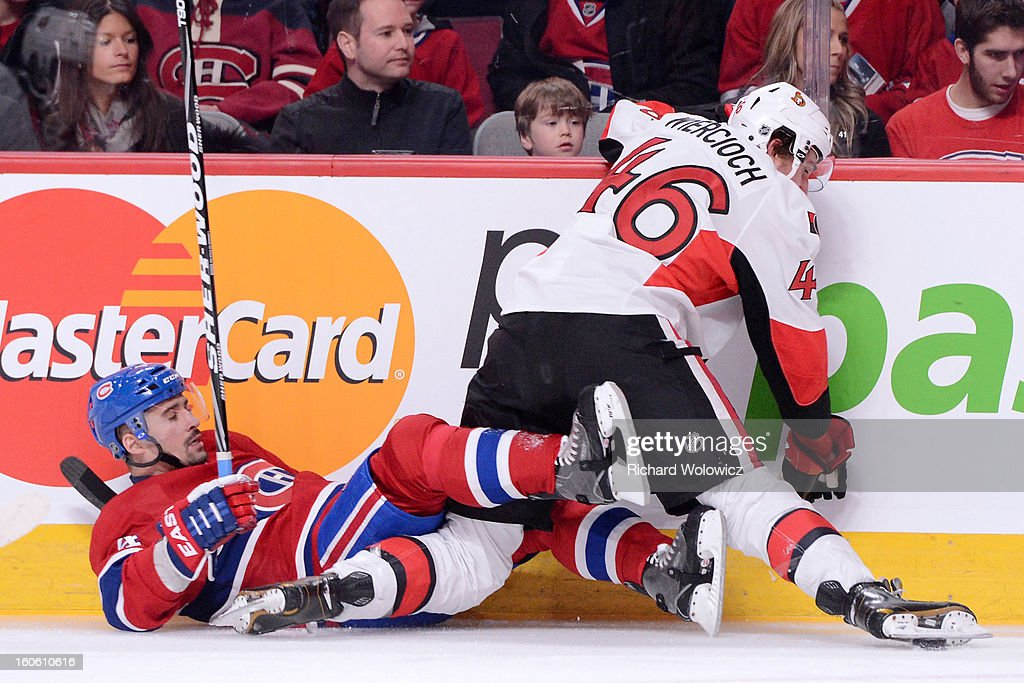 Tomas Plekanec #14 of the Montreal Canadiens falls while battling for position with Patrick Wiercioch #46 of the Ottawa Senators during the NHL game at the Bell Centre on February 3, 2013 in Montreal, Quebec, Canada. The Canadiens defeated the Senators 2-1.