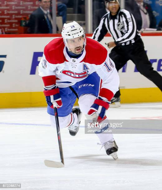 Tomas Plekanec of the Montreal Canadiens follows the play down the ice during first period action against the Winnipeg Jets at the Bell MTS Place on...
