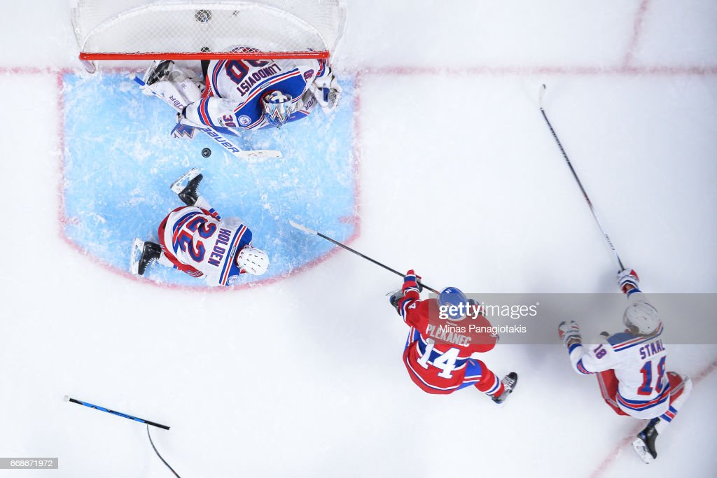 Tomas Plekanec #14 of the Montreal Canadiens gets a shot on goaltender Henrik Lundqvist #30 of the New York Rangers in Game Two of the Eastern Conference First Round during the 2017 NHL Stanley Cup Playoffs at the Bell Centre on April 14, 2017 in Montreal, Quebec, Canada. The Montreal Canadiens defeated the New York Rangers 4-3 in overtime.