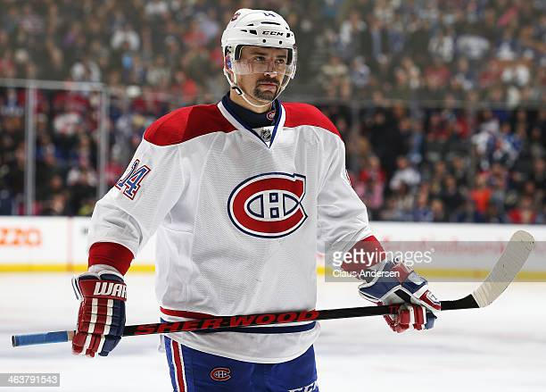 Tomas Plekanec of the Montreal Canadiens gets set for a faceoff against the Toronto Maple Leafs during an NHL game at the Air Canada Centre on...